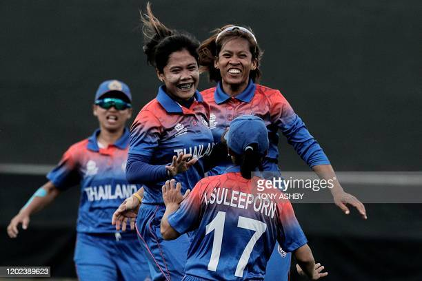 Chanida Sutthiruang of Thailand celebrates with teammates after taking a wicket during the women's Twenty20 World Cup cricket match between West...