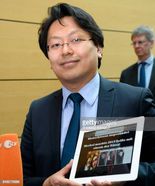 Chanjo Jun lawyer of Syrian refugee Anas Modamani talks to the media in the district court in Wuerzburg southern Germany on March 7 2017 The court...