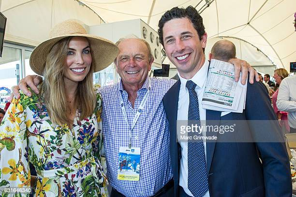 Channel 7 Chairman Ryan Stokes with his wife Claire Stokes and Gerry Harvey attend Magic Millions Raceday on January 14 2017 in Gold Coast Australia