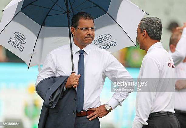 Channel 9 commentator Waqar Younis looks on during day three of the Second Test match between Australia and Pakistan at Melbourne Cricket Ground on...