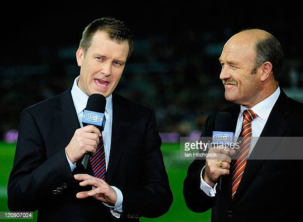 Channel 9 commentators Wally Lewis and Andrew Voss do a piece to camera before the start of the round 23 NRL match between the North Queensland...