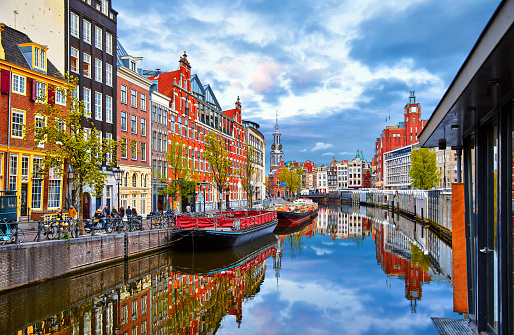 Channel in Amsterdam Netherlands houses river Amstel 1143539287