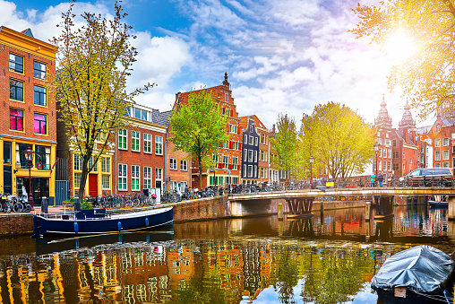 Channel in Amsterdam Netherlands houses river Amstel 938523984