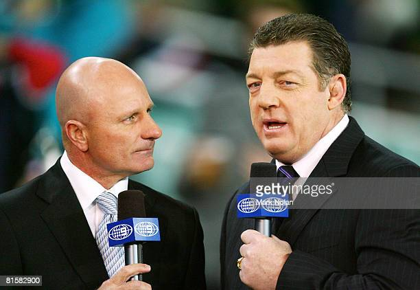Channel Nine commentators Peter Sterling and Phil Gould talk on camera before the round 14 NRL match between the Sydney Roosters and the Penrith...