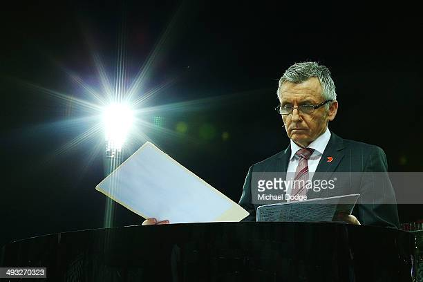 Channel Seven commentator Bruce McAvaney studies notes during the round 10 AFL match between the Geelong Cats and the North Melbourne Kangaroos at...