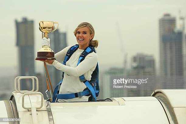 Channel seven presenter Edwina Bartholomew holds the Emirates Melbourne Cup in the Melbourne Star cabin during a live broadcast on sunrise ahead of...