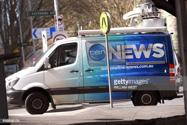 Channel Ten news van arrives at the network's headquarters in Sydney on August 28, 2017. - American broadcaster CBS has secured a deal to buy...
