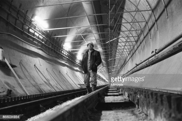 Channel Tunnel Construction 28th November 1987 One of the tunnellers of the service tunnel for the Channel Tunnel inspects the work completed so far...