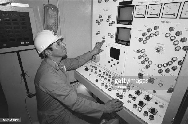 Channel Tunnel Construction 28th November 1987 Operator of the small bore machine keeps an eye on the controls to ensure that the English side of the...