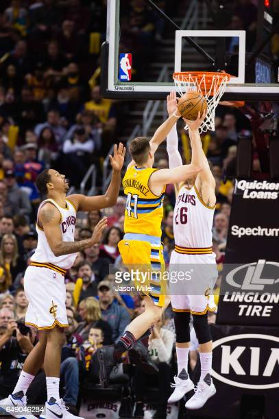 Channing Frye and Kyle Korver of the Cleveland Cavaliers attempt to block Juancho Hernangomez of the Denver Nuggets during the second half at Quicken...