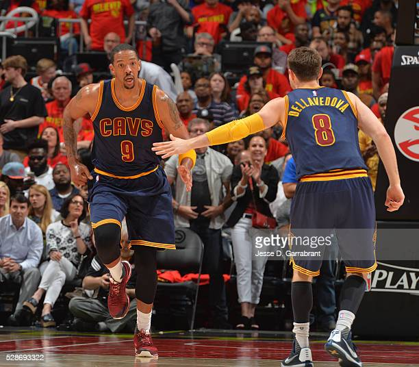 Channing Frye and Matthew Dellavedova of the Cleveland Cavaliers shake hands against the Atlanta Hawks during the Eastern Conference Semifinals Game...