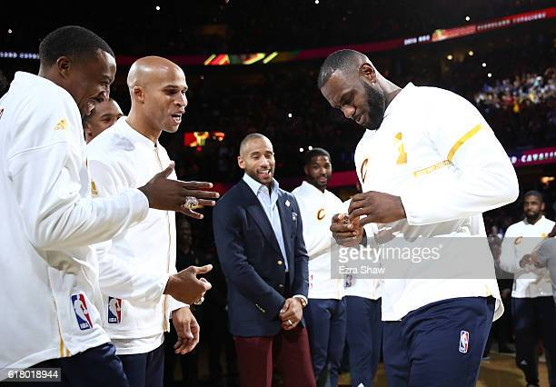 Channing Frye and Richard Jefferson react with LeBron James of the Cleveland Cavaliers after receiving their championship rings before the game...