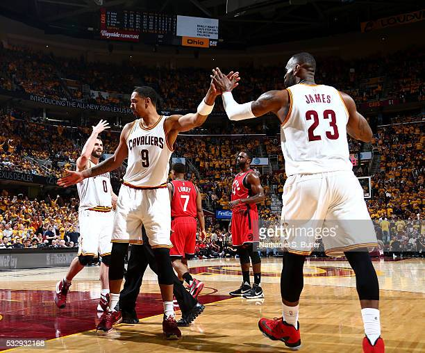 Channing Frye high fives teammate LeBron James of the Cleveland Cavaliers during Game Two of the Eastern Conference Finals during the 2016 NBA...