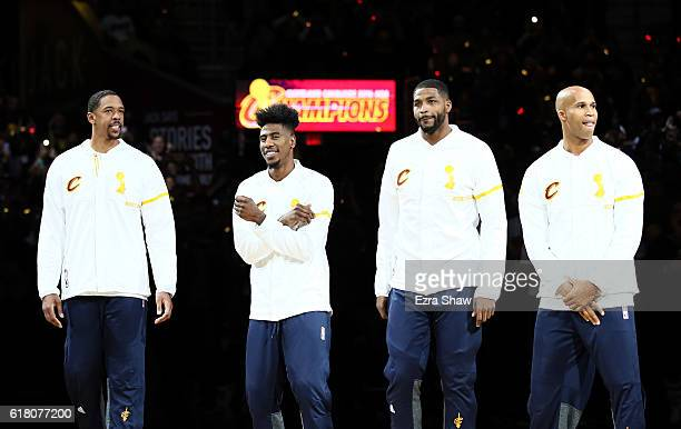 Channing Frye Iman Shumpert Tristan Thompson and Richard Jefferson of the Cleveland Cavaliers look on during the championship banner raising and ring...