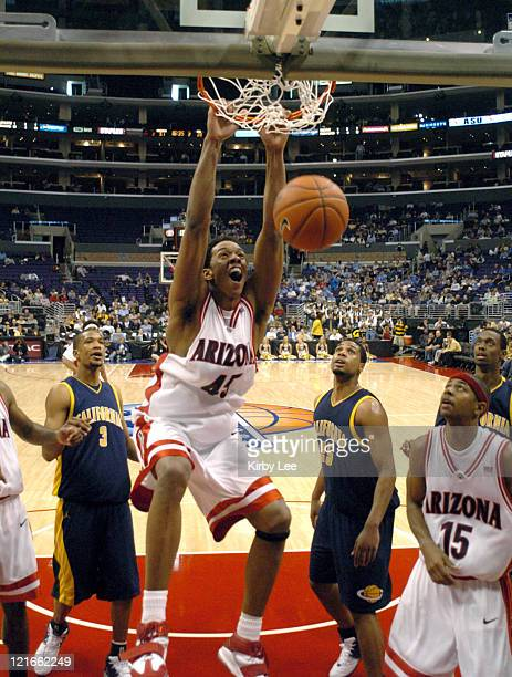 Channing Frye of Arizona dunks during 8863 victory over Cal in the first round of the Pacific Life Pac10 men's basketball tournament at Staples...