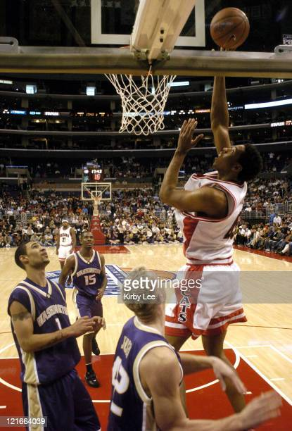Channing Frye of Arizona shoots over Tre Simmons and Mike Jensen of Washington during 8172 loss in the Pacific Life Pac10 Tournament Championship at...