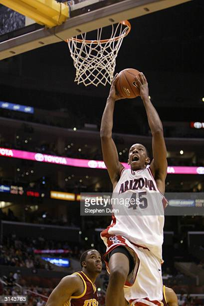 Channing Frye of the Arizona Wildcats dunks the ball against the USC Trojans during the quarterfinals of the 2004 Pacific Life Pac10 Tournament at...