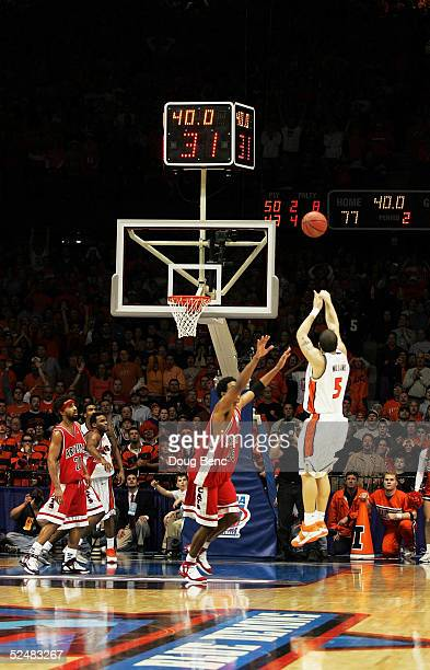 Channing Frye of the Arizona Wildcats rushes to cover as Deron Williams of the Illinois Fighting Illini hits the game tying three point basket to...
