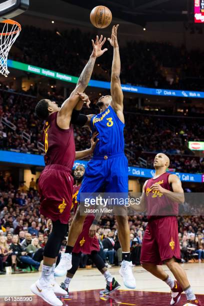 Channing Frye of the Cleveland Cavaliers attempts to block David West of the Golden State Warriors during the first half at Quicken Loans Arena on...