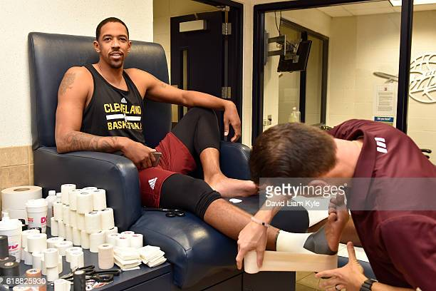 Channing Frye of the Cleveland Cavaliers gets taped up before the game against the New York Knicks on October 25 2016 at Quicken Loans Arena in...