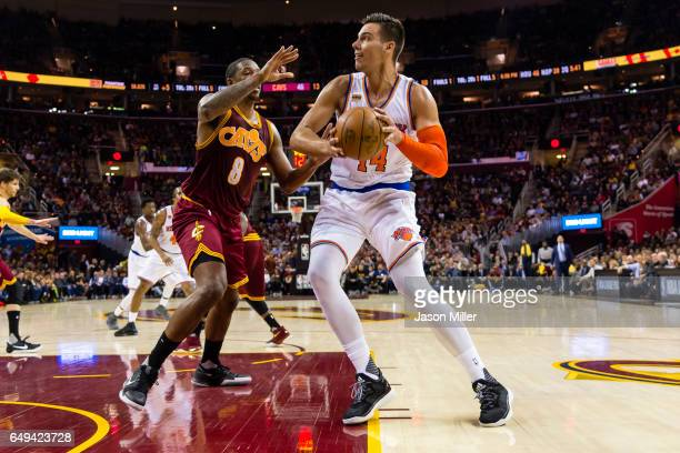 Channing Frye of the Cleveland Cavaliers puts pressure on Willy Hernangomez of the New York Knicks during the first half at Quicken Loans Arena on...
