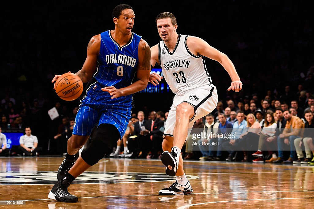Channing Frye #8 of the Orlando Magic dribbles past Mirza Teletovic #33 of the Brooklyn Nets at the Barclays Center on November 9, 2014 in the Brooklyn borough of New York City.