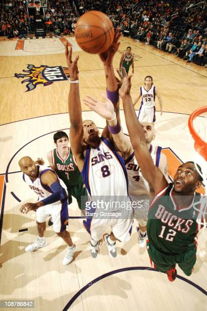 Channing Frye of the Phoenix Suns battles for a rebound with teammate Marcin Gortat and Luc Mbah a Moute of the Milwaukee Bucks in an NBA game played...