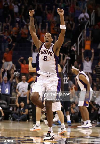 Channing Frye of the Phoenix Suns celebrates after Jason Richardson tied the game in the final seconds to force overtime against the Memphis...