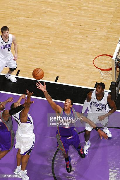 Channing Frye of the Phoenix Suns rebounds against Kenny Thomas and Jason Thompson of the Sacramento Kings during the game at Arco Arena on January 5...