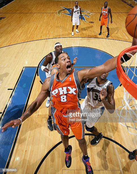 Channing Frye of the Phoenix Suns shoots against Brendan Haywood of the Washington Wizards at the Verizon Center during game on November 8 2009 in...