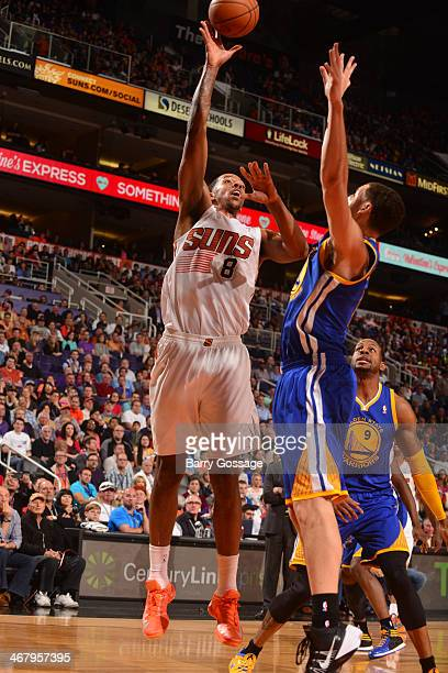 Channing Frye of the Phoenix Suns shoots against the Golden State Warriors on February 8 2014 at US Airways Center in Phoenix Arizona NOTE TO USER...