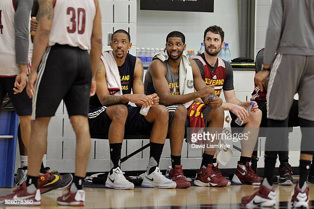 Channing Frye Tristan Thompson and Kevin Love of the Cleveland Cavaliers look on during an all access practice at The Cleveland Clinic Courts on...