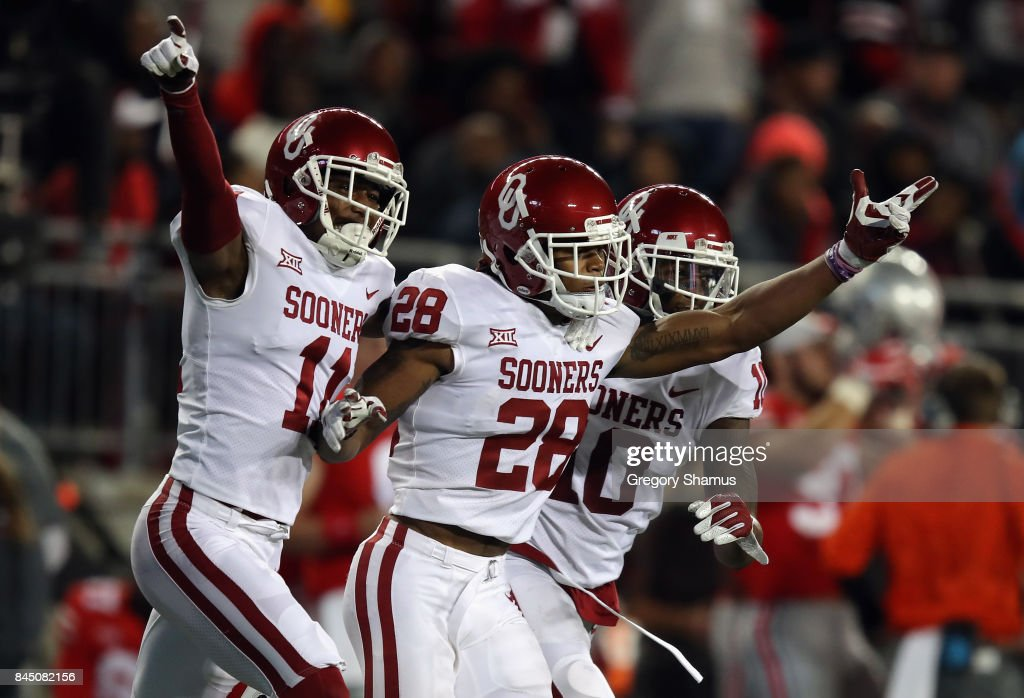 Chanse Sylvie #28 celebrates with Steven Parker #10 and Parnell Motley #11 of the Oklahoma Sooners during the second half against the Ohio State Buckeyes at Ohio Stadium on September 9, 2017 in Columbus, Ohio.