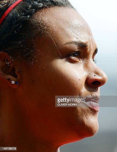 US' Chantae Mcmillan reacts after competing in the women's heptathlon 100m hurdles heats at the athletics event during the London 2012 Olympic Games...