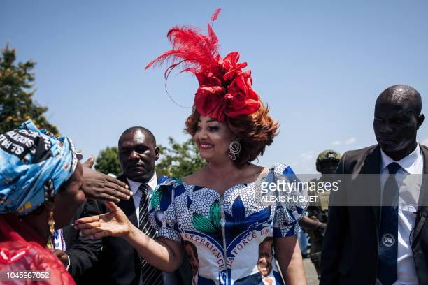 TOPSHOT Chantal Biya Cameroons First Lady greets supporters of her husband at Maroua airport in the Far North Region of Cameroon ahead of an...