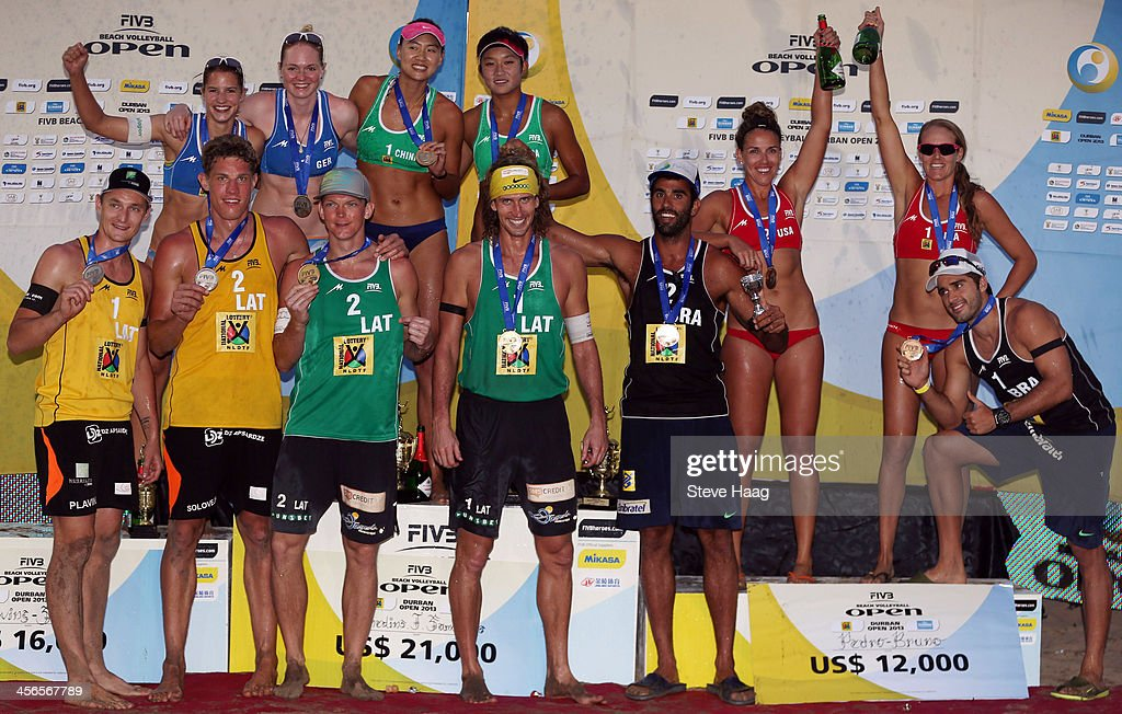 Chantal Laboureur and Julia Sude of Germany, Chen Xue and Xinyi Xia of China, Whitney Pavlik and Jennifer Kessy of USA, (front row L-R) Martins Plavins and Aleksandrs Solovejs of Latvia, Janis Smedins and Aleksandrs Samoilovs of Latvia, and Pedro Solberg Salgado and Bruno Oscar Schmidt of Brazil pose during the medals ceremony at the FIVB Durban Open at New Beach on December 14, 2013 in Durban, South Africa.