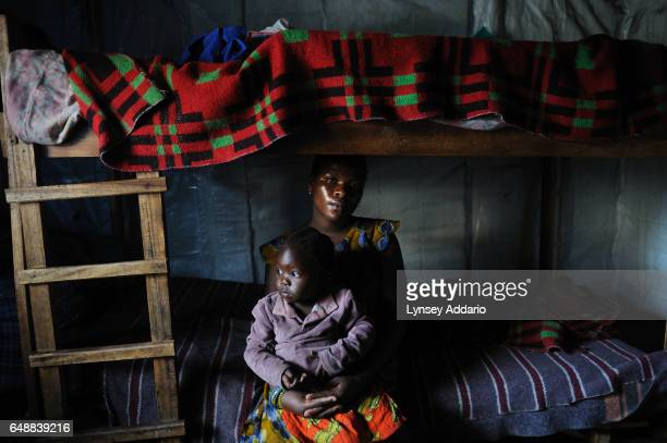 Chantal orphaned by the war sits with her baby Baraca in an orphanage in Goma North Kivu province Democratic Republic of the Congo on Nov 28 2008...