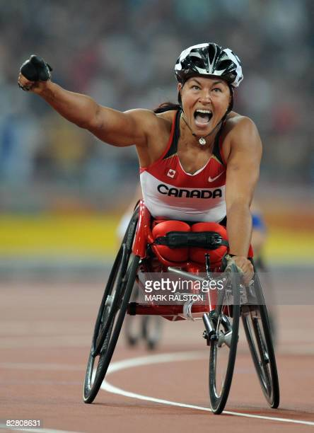 Chantal Petitclerc of Canada celebrates after winning the final of the women's 800 metre T54 classification event at the 2008 Beijing Paralympic...