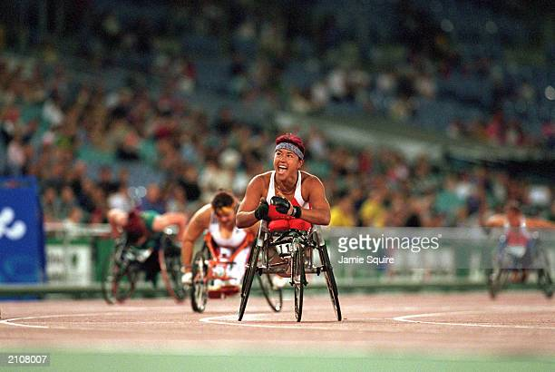 Chantal Petitclerc of Canada celebrates her win in the Womens 200m T54 Final during the Sydney 2000 Paralympic Games on October 27, 2000 at Olympic...