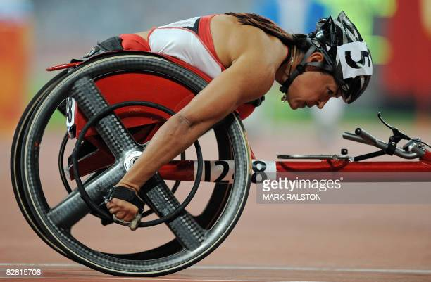 Chantal Petitclerc of Canada races before winning the final of the women's 800 metre T54 classification event at the 2008 Beijing Paralympic Games in...