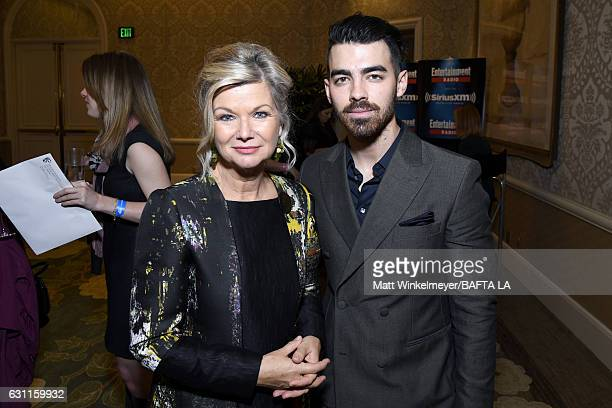 BAFTA LA CEO Chantal Rickards and musician Joe Jonas attend The BAFTA Tea Party at Four Seasons Hotel Los Angeles at Beverly Hills on January 7 2017...