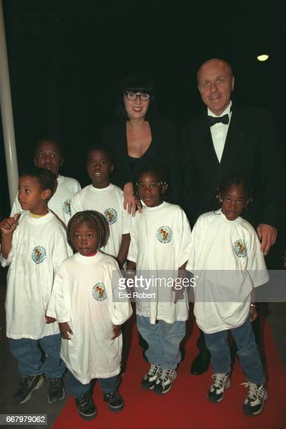 Chantal Thomass and her husband surrounded by children