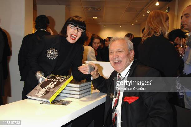 Chantal Thomass and photographer Ron Galella attend the opening of Warhol by Galella at Le Bon Marche Paris on February 28 2008 in Paris France