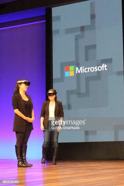 Chantal Tremblay and Genevieve Pesant shows how HoloLens augmented reality gear will be used to design new shows during a Microsoft developers...