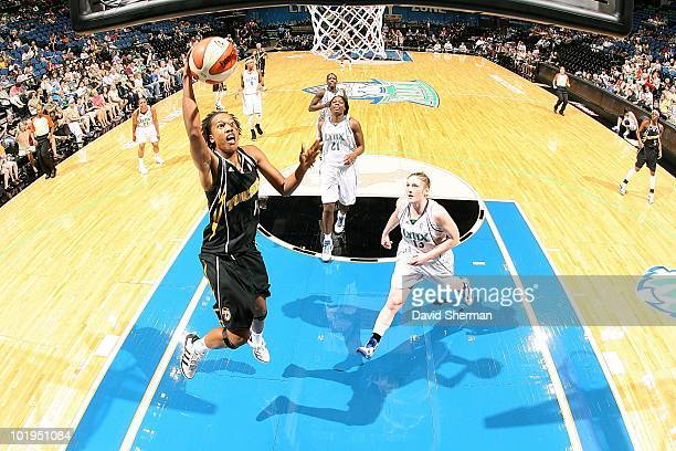 Chante Black of the Tulsa Shock goes to the basket against Lindsay Whalen of the Minnesota Lynx during the WNBA game on May 23 2010 at Target Center...