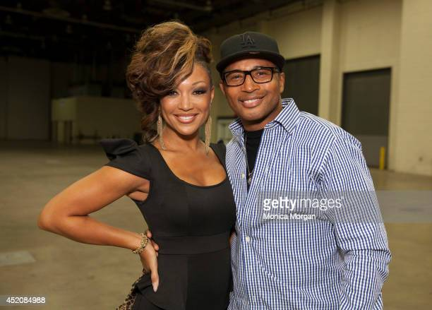 Chante Moore and Kevon Edmond attend the 2014 Radio One Women Empowerment Expo on July 12 2014 in Detroit Michigan