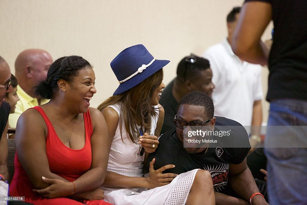 Chantel Christopher, Gabrielle Union and Dwyane Wade share a laugh during the games at Dwyane Wade's Fourth Annual Fantasy Basketball Camp at Westin Diplomat on August 3, 2014 in Hollywood, Florida.