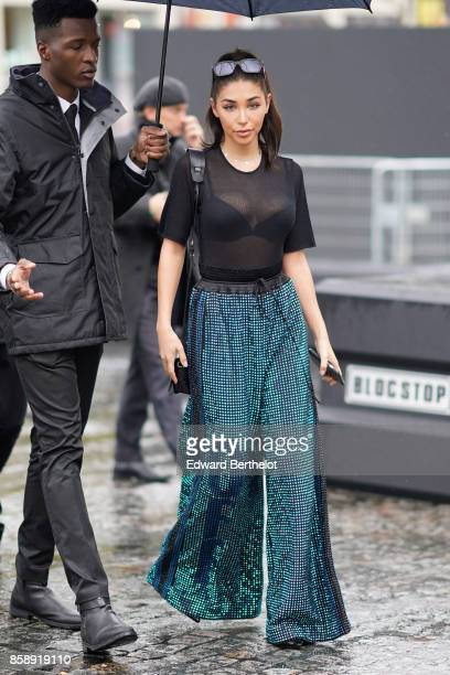 Chantel Jeffries wears sunglasses a mesh black top black bras flare pants attends Le Defile L'Oreal Paris as part of Paris Fashion Week Womenswear...