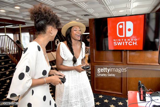 Chantel Riley and guest test their skills on Super Smash Bros Ultimate for Nintendo Switch at the Variety Studio at ComicCon 2018 on July 20 2018 in...