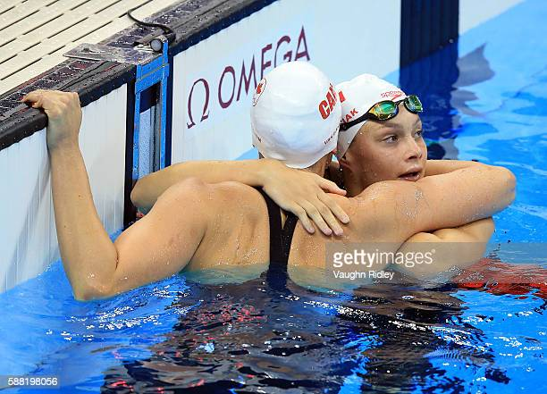 Chantel Van Landeghem and Penny Oleksiak of Canada embrace following the Women's 100m Freestyle Heats on Day 5 of the Rio 2016 Olympic Games at the...